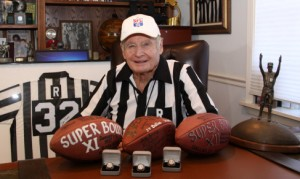 Tunney with superbowl rings and footballs