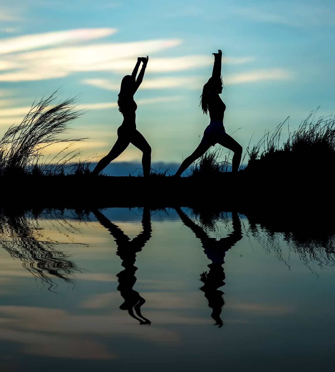 two ladies stretch with reflections and shadows
