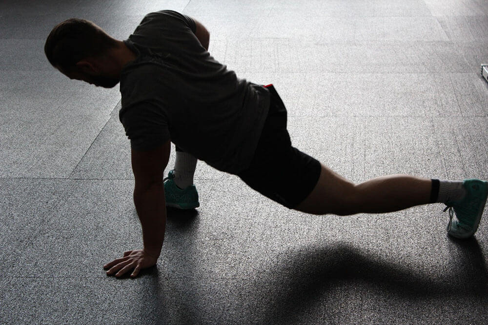man doing a stretching exercise on the floor